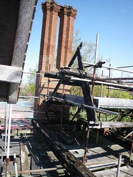 Scaffolding supporting the fire-damaged timber frame