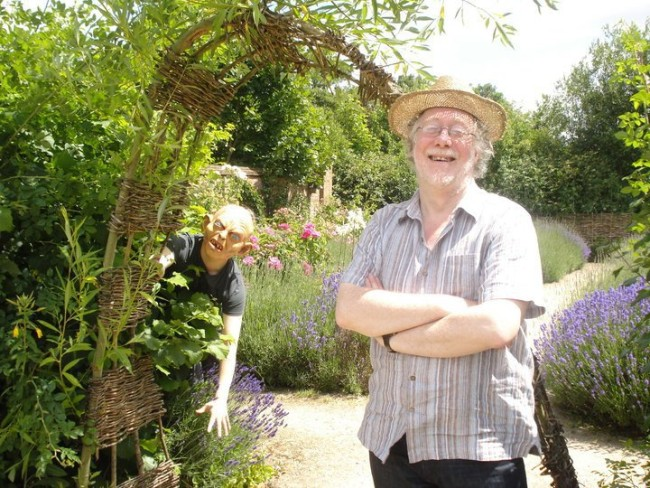 Our first Literary Bus meeting was at Blakesley Hall in 2010. This picture became synonymous with the project, with Gollum peering behind Chris in Blakesley's beautiful gardens. © Anne-Marie Hayes